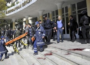 Conflicting identity: According to official sources, (pictured is) the victim of the shooting inside the Azerbaijan Oil Academy in Baku. Other sources, however, say this might be the other attacker who according to some eyewitnesses was wearing a cap and a jacket. Russiatoday.com has also posted a video on their website identifying the same person as 'terrorist'. (Getty Images)