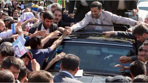 Iranian President Mahmoud Ahmadenijad greets a cheering crowd in Semnan province after Iran successfully tested its Sejile-2 missile (Atta Kenare/AFP/Getty Images)