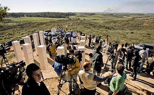"Reporters, banned from entering Gaza, watch Israel's ""Operation Cast Lead"" from a distant hilltop (AP)"