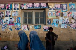 Posters of various presidential candidates stuck on walls in Kabul. Photo - Tyler Hicks/NYT