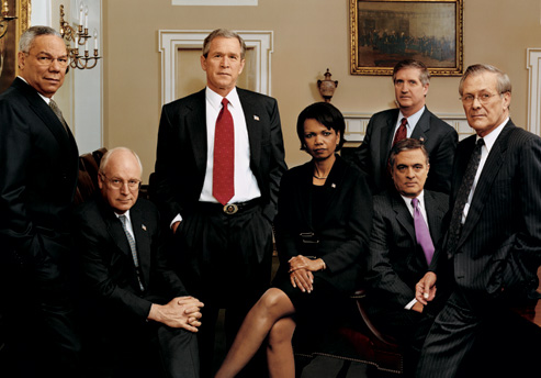 George W. Bush and his inner circle, photographed in the Cabinet Room of the White House in December 2001. From left: Secretary of State Colin Powell, Vice President Dick Cheney, the president, National-Security Adviser Condoleezza Rice, White House chief of staff Andrew Card, C.I.A. director George Tenet (seated), and Secretary of Defense Donald Rumsfeld. Photograph by Annie Leibovitz