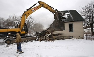 A house in Detroit is demolished (Carlos Osorio/AP)