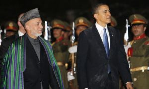 U.S. President Barack Obama with Afghanistan President Hamid Karzai in March (Charles Dharapak/AP)