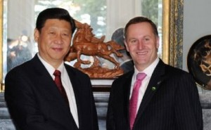 Chinese Vice President Xi Jinping shakes hands with New Zealand Prime Minister John Key in Auckland, New Zealand, on June 18, 2010. (Rao Aimin/Xinhua)