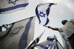 Israeli youths wave flags.