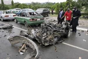 Investigators inspect an exploded vehicle in Abuja. (Pius Utomi Ekpei/AFP/Getty Images)