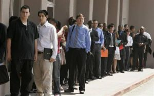 People wait in line at a job fair in Los Angeles (Reuters)