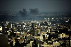 Smoke rises over Tripoli, Libya, on August 22, 2011 (Filippo Monteforte/AFP)
