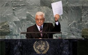 Palestinian President Mahmoud Abbas holds up a copy of a letter formally requesting U.N. membership for a Palestinian state at the General Assembly on September 23, 2011 (Mike Segar/Reuters)