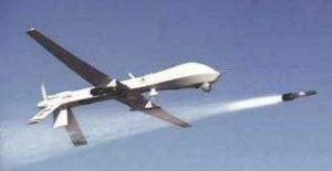 A Predator drone fires a Hellfire missile (Photo: NATO)