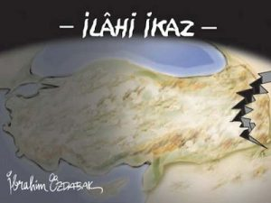 """An image that appeared in the October 24, 2011 issue of daily newspaper Yeni Asya reading """"divine justice""""."""