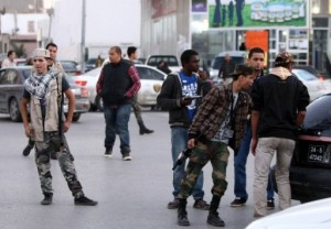 Militia members man a checkpoint in Tripoli, Libya (Mahmud Turkia, AFP)