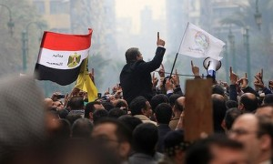 Supporters of Egypt's Muslim Brotherhood shout slogans outside the parliament in Cairo on January 23, 2012. (Photo: Mahmud Hams)