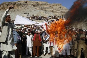 Afghan protest in response to the burning of Korans by American forces (Rahmat Gul/AP)