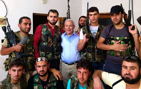 Syrian National Council leader Burhan Ghalioun poses with Syrian free army in Sarmada, near the Turkey-Syria border June 26, 2012. (Photo: Stringer/Reuters)