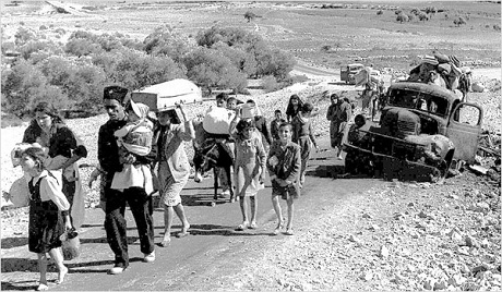 Palestinian refugees leaving Galilee, 1948 (Fred Csasznik)