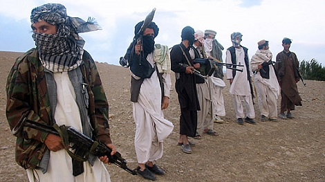 Taliban fighters on a hillside at Maydan Shahr in Wardak province, west of Kabul. (AFP/Getty)