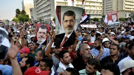 Supporters of Mohamed Morsi march in Cairo on July 5, 2013 (AFP)