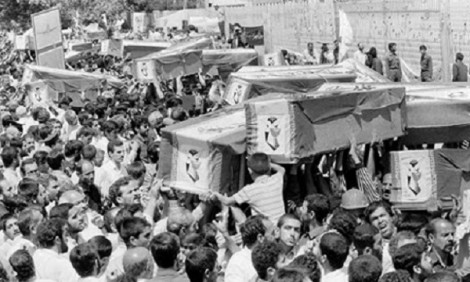Mourners carry coffins through the streets of Tehran, July 7, 1988, during a mass funeral for victims who died when Iran Air Flight 655 was blown out of the sky by the USS Vincennes. (Associated Press)