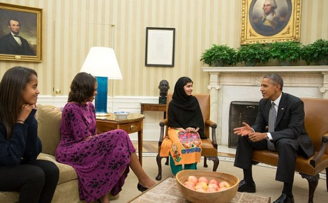 United States President Barack Obama, First Lady Michelle Obama, and their daughter Malia meet with Malala Yousafzai, a young Pakistani schoolgirl who was shot in the head by the Taliban in 2012, in the Oval Office on 11 October 2013 (Pete Souza/The White House)