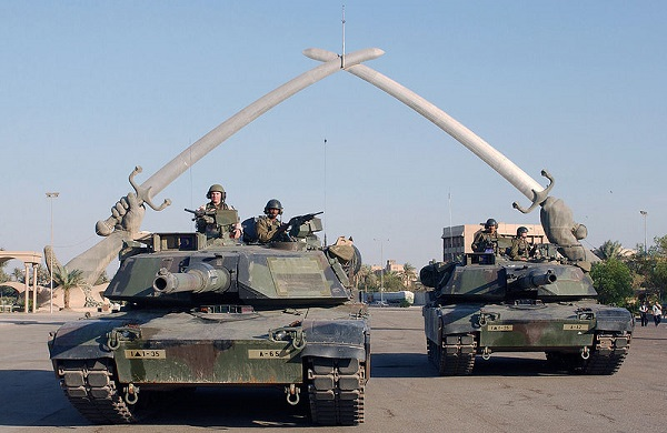 "US Army M1A1 tanks at the ""Hands of Victory"" in Ceremony Square in Baghdad, Iraq"