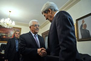 Palestinian Authority President Mahmoud Abbas greets U.S. Secretary of State John Kerry as he arrives for a meeting in Amman, Jordan, on June 29, 2013. (US Department of State)