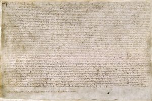 The Magna Carta (originally known as the Charter of Liberties) of 1215, written in iron gall ink on parchment in medieval Latin, using standard abbreviations of the period, authenticated with the Great Seal of King John. (British Library/Public Domain)