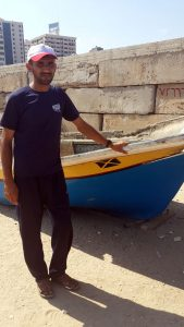 Mohammed Zeyad with his damaged boat.