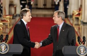 UK Prime Minister Tony Blair shakes hands with fellow war criminal George W. Bush at the White House, November 12, 2004 (White House)