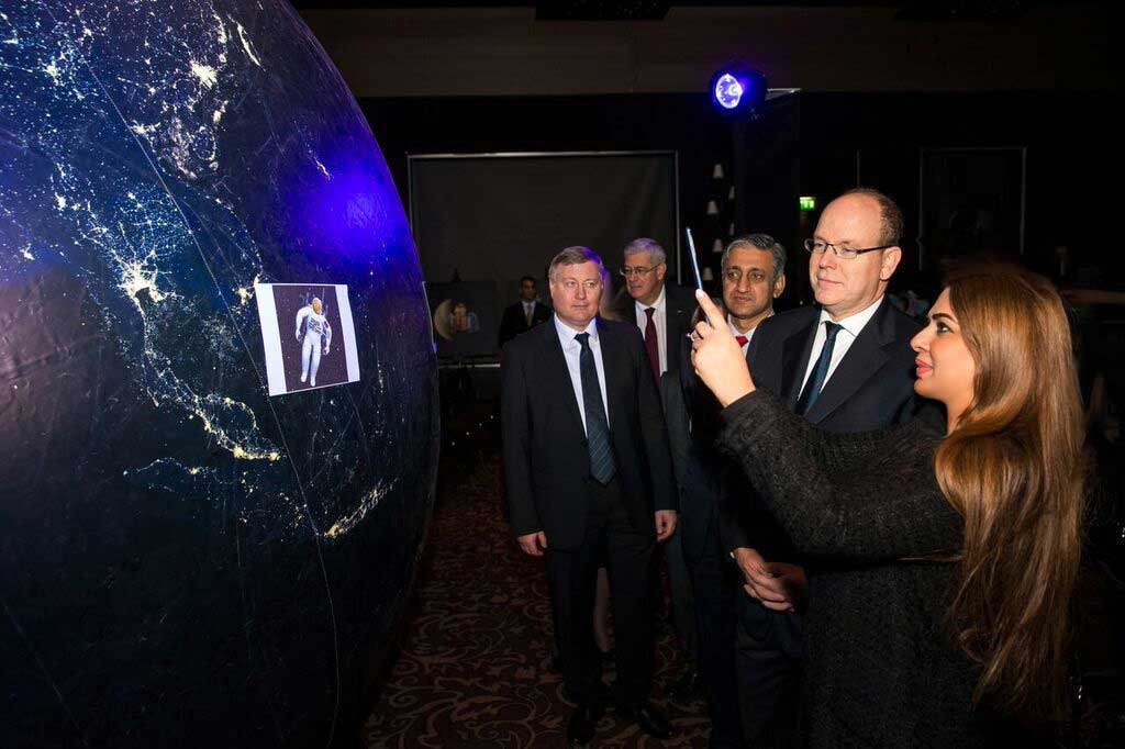 Namira Salim, Founder Space Trust shows an interactive 3D APP via a tablet to HSH Prince Albert II, Sovereign Prince of Monaco during the inaugural conference and exhibition of Space Trust on November 29th 2015.‎ (© Philippe Fitte 2015)