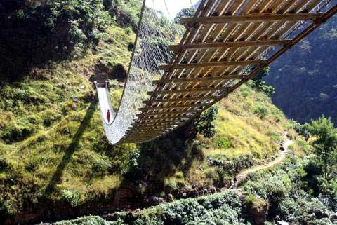 Swinging bridges are common in rural Nepal (Photo: Alonzo Lyons)