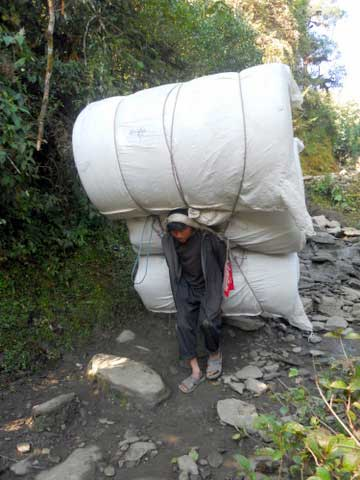 Superhuman loads hauled by superhuman porters of Nepal (Photo: Alonzo Lyons)