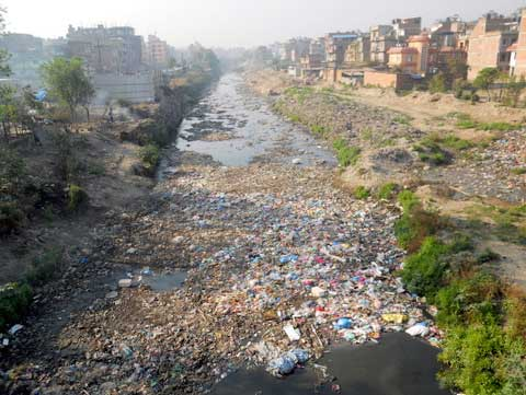 Kathmandu's Vishnumati River was once sacred and now refuse is openly dumped into it (Photo: Alonzo Lyons)