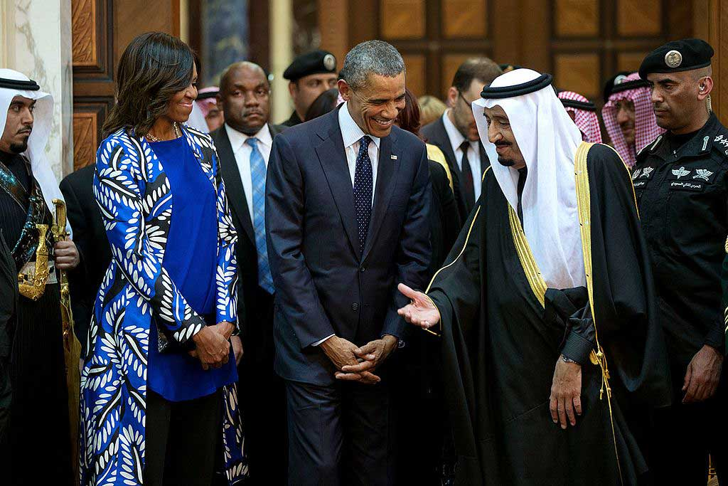 President Barack Obama and First Lady Michelle Obama walk with King Salman bin Abdulaziz of Saudi Arabia at Erga Palace in Riyadh, Saudi Arabia, Jan. 27, 2015. (Pete Souza/White House)