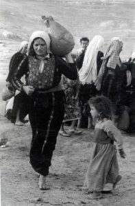 A Palestinian woman and child (Source: Hanini.org/CC BY 3.0)