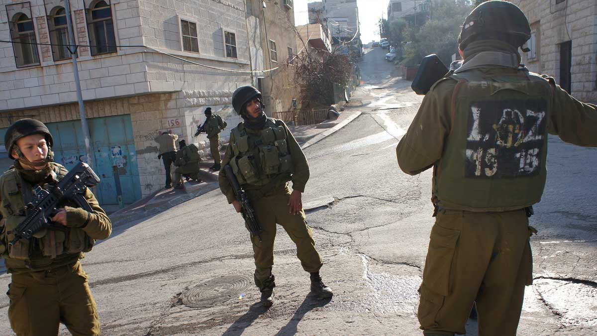 Israeli soldiers at the Gilbert checkpoint in Hebron, in the occupied West Bank (Public Domain)