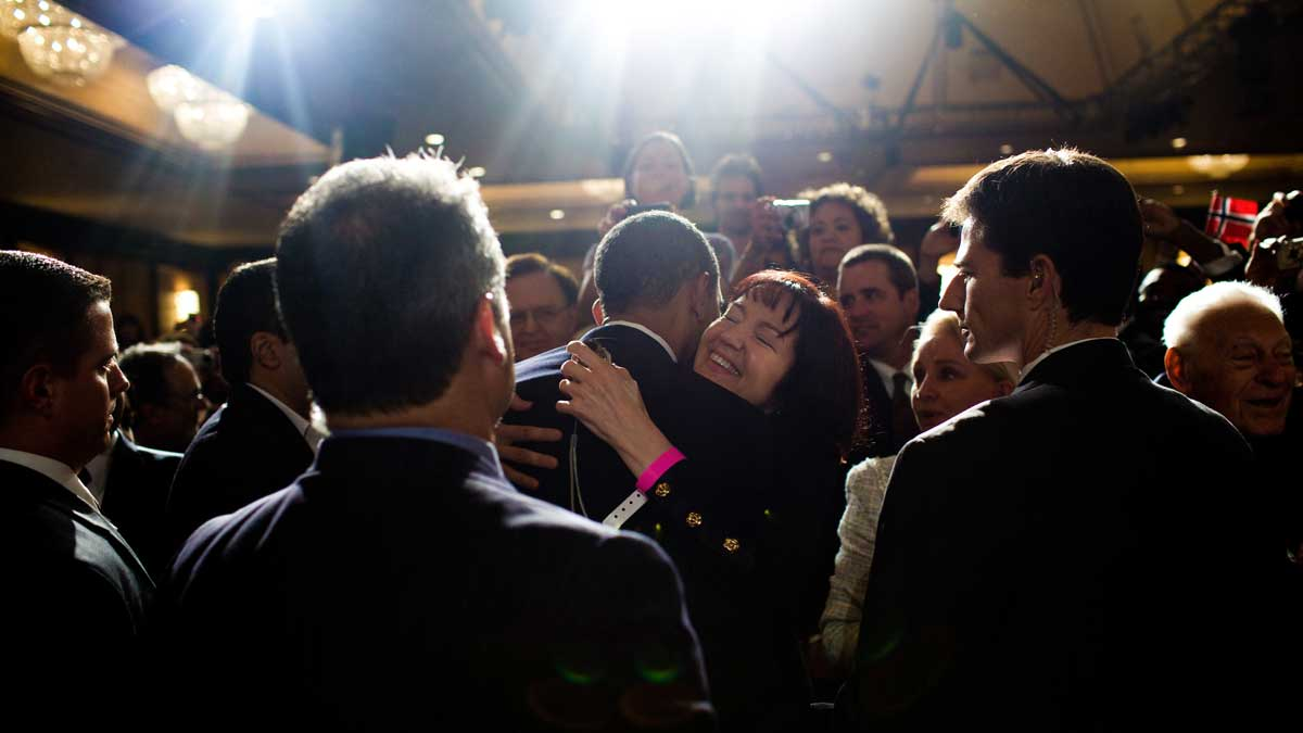 President Barack Obama, who by the end of his second term had bombed more than half a dozen countries, greets guests at a Democratic National Committee reception on October 15, 2009. (White House)