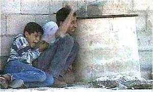 Jamal and Muhammad al-Durrah taking cover from Israeli fire in the Gaza Strip, September 30, 2000 (France 2/Fair Use)