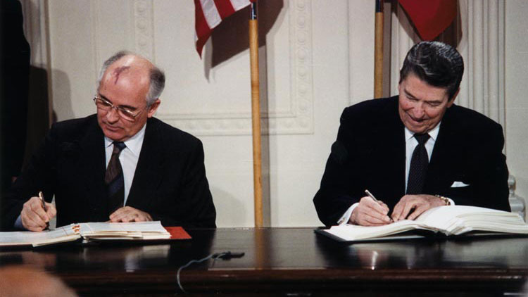 President Reagan and General Secretary Gorbachev signing the INF Treaty in the East Room of the White House, December 8, 1987 (White House)